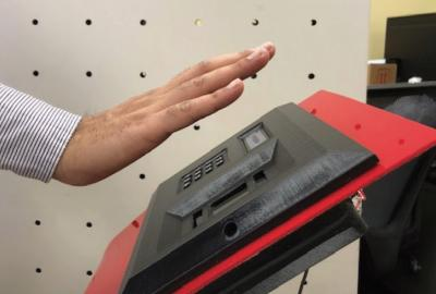 Hand above contactless biometric scanner